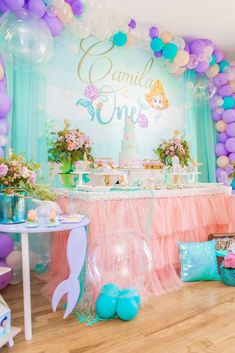 This Under the Sea Birthday Party is fabulous!! The dessert table is so pretty. Love the balloon garland and coral chiffon table skirt! See more party ideas and share yours at CatchMyParty.com #catchmyparty #mermaidbirthdayparty #undertheseabirthdayparty #girl1stbirthdayparty #mermaiddesserttable