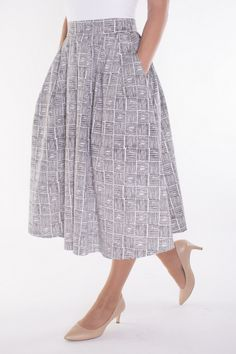 The polished casual look that only a midi skirt can provide with the best accessory: pockets.  Sophisticated dressing is easy in classically cut, feminine skirts.