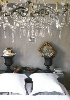love the color of the walls, with the white bedding and the chandelier.