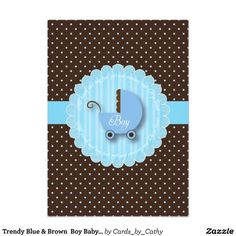 Trendy Blue & Brown Boy Baby shower Invitations with polka dots and Stripe patterns. A cute little Pram in blue and brown with the word Boy in script font against a striped blue circle with cute phrase. All of this is set against a polka dot background.