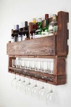 Wine rack made from reclaimed wood. Grab a bottle and pour both of you a glass...