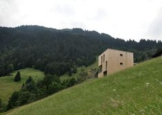 This cube-shaped holiday house in Austria's mountainous Vorarlberg region was designed by Exit Architects to contrast with its more traditional neighbours.