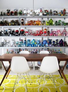 Collection of vinyl toys on a dining room wall