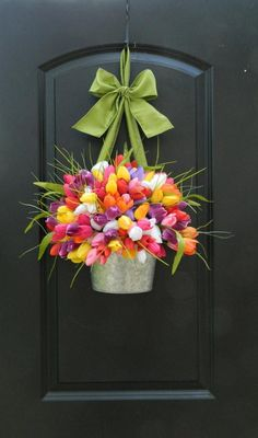Bright Spring Wreath - Customized Tulip Wreath - Many Colors - You Choose Color Combo, This galvanized wall basket is bursting with artificial tulips in your choice of color, all topped with a bow in the color of your choice (over 65 rib. Bright Spring, Beautiful Front Doors, Tulip Wreath, Tulip Bouquet, Spring Door, Spring Wreaths For Front Door Diy, Baskets On Wall, Wall Basket, Front Door Decor