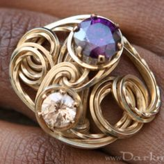 Janice Kuhm wire jewelry ring design... pretty cool and I could see a lot of different unique designs with this style.