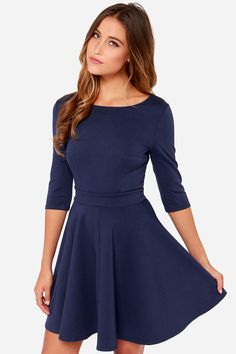 """The Just a Twirl Navy Blue Dress wants you to stop standing still and start spinning! Stretchy knit is thick enough to wear on a chilly day as it hugs your curves down half sleeves and a fitted bodice with a rounded neckline and unique seam details. A banded waist is just the beginning of a full skirt that flares to twirl-worthy perfection. Hidden back zipper. Unlined. Model is 5'8"""" and is wearing a size Small. 65% Rayon, 30% Nylon, 5% Spandex. Hand Wash Cold."""