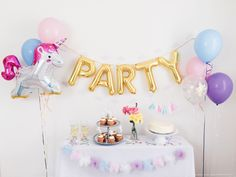 Unicorn Party Box by OhShinyPaperCo - party letter balloons cloud garland unicorn cake toppers tassel cake topper confetti tulle pom garland by OhShinyPaperCo on Etsy https://www.etsy.com/listing/209533743/unicorn-party-box-by-ohshinypaperco