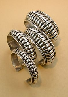 "Hand hammered bracelets by Navajo artist Thomas Charley. I have the 1"" one, it has been my favorite piece for years - goes with everything!"