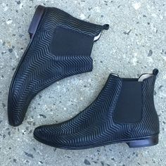 Black ankle booties Vera in embossed leather made using old world Sacchetto construction. Flat heel chelsea boots for your ultimate sock-line comfort available in extended size 5-13.