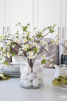 Learn how to make this GORGEOUS quick 10 minute floral arrangement with DIY Easter Egg vase filler! shared at katherines corner