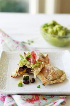 Easy Healthy Vegetable Empanadas - These look good, but I may have to add meat and substitute the guac for salsa to get my husband to eat them.