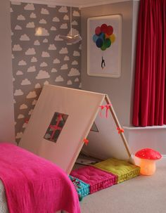 the boo and the boy: eclectic kids rooms- love that cloud wall paper!