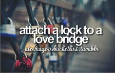 attach a lock to a love bridge in Paris, France the throw the key in the water to symbolize an everlasting love