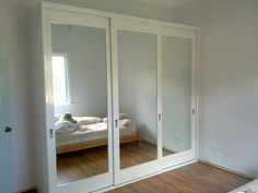 Mirror with timber frame doors - Reflections Built-In Wardrobes, Carpenter, Blacktown, NSW, 2148 - TrueLocal