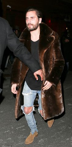 Party boy: Scott Disick partied the night away on Thursday and most of the morning with a group of beautiful models at 1Oak nightclub and then a nearby apartment in NYC