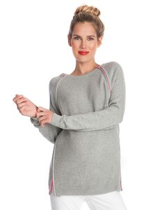 <ul> <li> Double zip 4-way nursing access </li> <li> 100% cotton knit</li> <li> Textured knit front </li> <li> Leatherette neon zip detailing </li> <li> Full length sleeves </li> </ul> <p> Contrast zip detailing in stunning hot pink gives our Double Zip Nursing Jumper a cool contemporary edge. Framing the soft grey textured knit panel at the front, the stylish pink zips create a modern fashion feature. After baby is born, they open at the top and bottom to offer 4- way breastfeeding access…