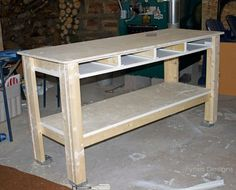 Craft room workbench that is tough, sturdy and can be built in a day on a small budget. A coat of paint takes it from boring garage to beautiful craft table.