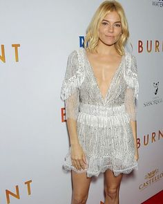 """""""Sienna Miller wears Rodarte's Hand Beaded White Lace and Fringe Dress to the premiere of @burnt_movie (styled by @kystyle)."""""""