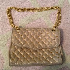 Rebecca minkoff quilted affair Gorgeous RM bag! Material has a gold shimmer to it and was one that quickly sold out on Shopbop! In great condition! Only has a few scratches on the magnetic closure (pictured) Rebecca Minkoff Bags