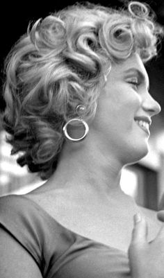 Marilyn Monroe photographed at a party for the release of Ray Anthony's song 'Marilyn' in August 3, 1952