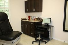 Exam room colors- black cabinets with orange marble sinks