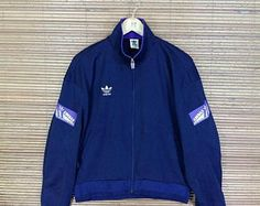 Vintage de 1990 ADIDAS rompevientos medio chaqueta trébol de Adidas 3 rayas ropa  deportiva azul Sport 58285b796a3