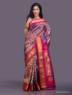 A show stop piece, this Paithani silk saree from top to toe is immersed in very intricate thread work done with much precision in a masterly fashion. Paithani silk uses the ancient technique of tapestry where multiple threads of different colours along with gold and silver threads are weaved together to form a fascinating piece of silk.