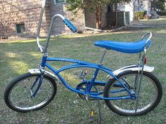 My bike as a kid was a Schwinn Stingray much like this one, except mine was orange and had one of those solid slick tires on the back.