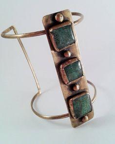 Oxidized brass cuff set with green glass stones. #metalarchon #metalsmith #brasscuff #brassjewelry #instametalsmith #instajewelrygroup