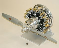 "JT 1800 9-Cylinder Radial Model Airplane Engine, designed and built by John v. Thompson, Kansas, early 1990's. L=14"", W=28"" (prop), H=14"""