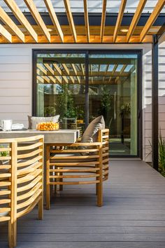 The geometric lines of the pergola juxtaposed with the lines of the outdoor furniture make such a bold, beautiful design statement on the deck --> http://www.hgtv.com/design/hgtv-smart-home/2015/deck-pictures-from-hgtv-smart-home-2015-pictures?soc=smartpin