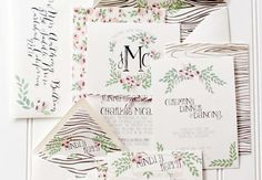 Hand painted floral and woodgrain wedding invitations by Moira Design Studio