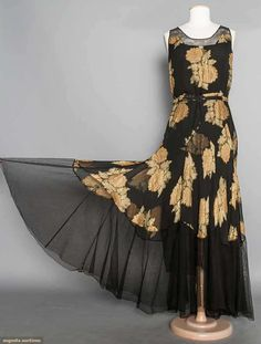 CHIFFON & LAME EVENING GOWN, 1930's |  Black chiffon w/ gold lame brocaded over apricot & pale green floral print, black net neckline band & hem flounce, attached black silk slip (front view)