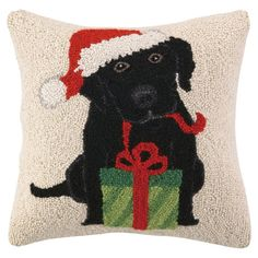 Hand-hooked wool pillow with a holiday-themed dog motif.   Product: PillowConstruction Material: Wool cover and...