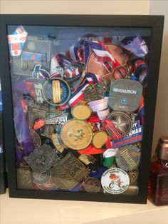 Medal storage/display idea! Use a shadow box to keep all your medals in one place. I used a top loading shadow box because it's easier to add a new medal to the collection.