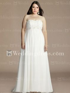Plus size chiffon wedding gown features exquisite lace appliqués and beading on the bodice.