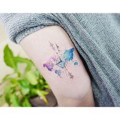 : World map + compass . . #tattooistbanul #tattoo #tattooing #worldmap #geometry #geometrytattoo #colortattoo #타투이스트바늘 #타투 #컬러타투 #세계지도타투 #기하학타투