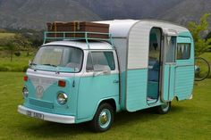 The exterior of a Tiffany blue redone hippie van! If I purchased this, I could make so many road trips and save money on hotels while doing it!