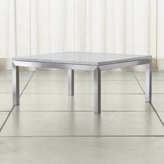 Shop Parsons White Marble Top/ Stainless Steel Base 36x36 Square Coffee Table.   To complement its clean, simple lines, the coffee table's stainless steel Parsons frame gets a soft, contemporary brushed finish that mimics mitered wood corners.