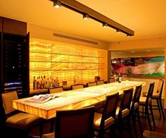 """Layering Light with LEDs: """"You don't necessarily need colored LED lighting to make a home festive, fun and to pop. Take a look at what home tech pro Marc Lewin of Visual Acoustics in Miami did with this white LED-backlit onyx bar."""""""
