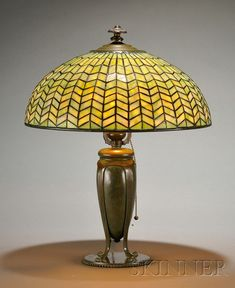 Tiffany Studios Table Lamp   Mosaic art glass and bronze   New York, early 20th century   Herringbone pattern mottled green glass dome-shaped shade, over single socket on ribbed urn-form verdigris bronze base