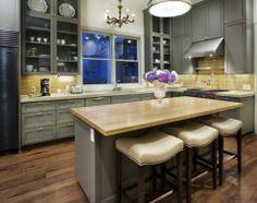 nice twist w the backsplash--traditional kitchen by Soledad Builders, LLC
