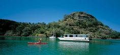 Charter a houseboat and explore Northland's beautiful Whangaroa Harbour.