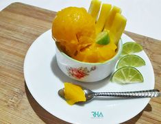 Mango Sorbet is the best way to cool down yourself on a hot summer day. It's creamy & refreshing; plus in a blender you can make mango sorbet in 5 min using 3 simple ingredients. Mango Sorbet, Summer Treats, Cantaloupe, Canning, Fruit, Simple, Hot, Desserts, Tailgate Desserts
