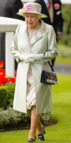 The Queen, resplendent in a beige coat and floral dress,as she arrived for the races on day two at Royal Ascot 2014