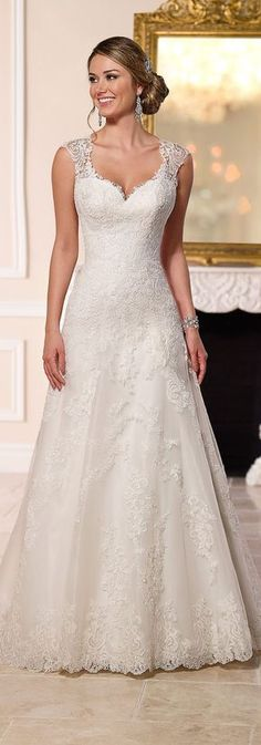 Match your beautiful lacy wedding dress with bold yet delicate in detail earrings. See suitable earrings here. #weddinggowns @happinessboutique.com