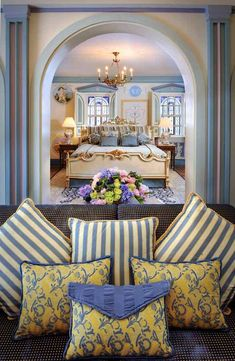 The blue-and-cream-colored Azure Suite includes a king bed and two full-sized beds/sitting alcoves. - TownandCountrymag.com
