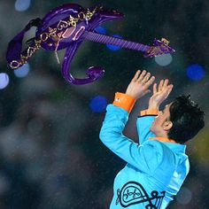 Prince during Super Bowl XLI Halftime Show Performance in 2007.