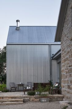 Photo 12 of 17 in A Limestone Cottage in Kansas Is Reborn With a Corrugated Steel Addition - Dwell Steel Siding, Steel Barns, Casa Hotel, Building Front, Building Ideas, Gable House, Black Barn, Rural House, House Siding