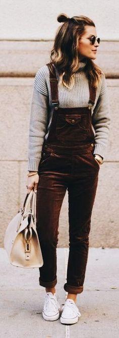 Brown velvet overalls over gray sweater.